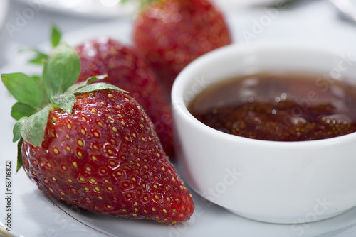 Jam with fresh strawberry