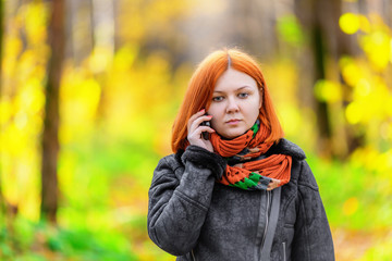 Portrait of beautiful smiling red-haired woman
