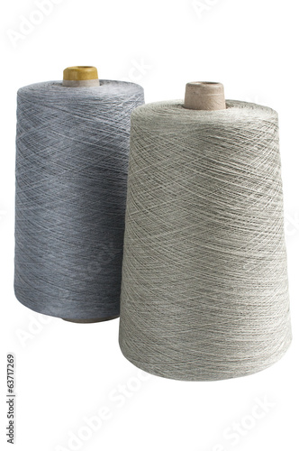 Coils with linen yarn isolated on white background