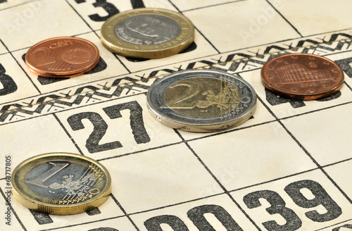 Euro coins on the cards for Russian lotto game.
