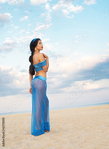 Full length portrait of a girl in belly dance costume