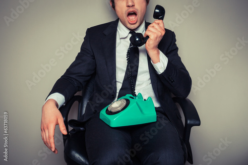 Surprised businessman on the phone