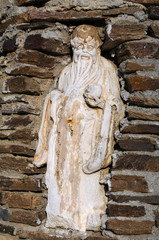 Old Man Statue in the Brick Wall