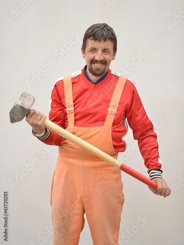 Builder with big metal hammer
