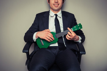Businessman playing ukulele