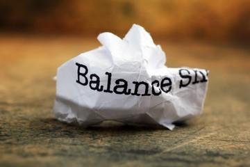 Balance crinkled paper