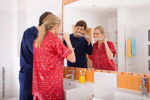 Couple brushing their teeth