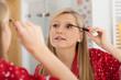 ������, ������: Blonde applying mascara