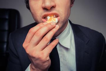 Businessman eating egg