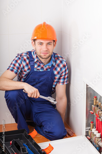 Plumber during valves reparation