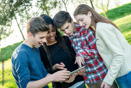 Group of Multiracial Teenage Friends with Tablet PC