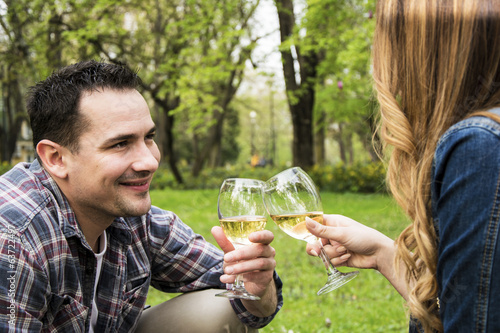 Couple toasting in park