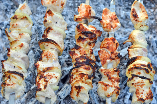 Shish kebab on skewers and hot coals