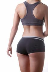 Девушка в спортивной одежде вид с зади