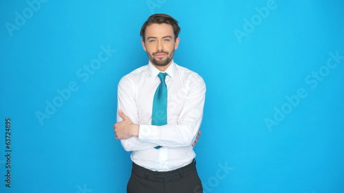 handsome businessman  posing on blue screen