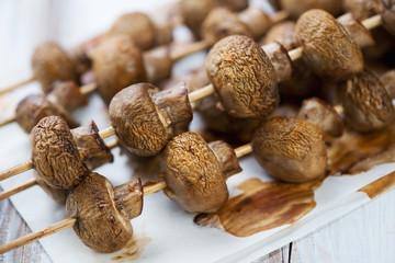 Close-up of baked champignon kebabs, horizontal shot