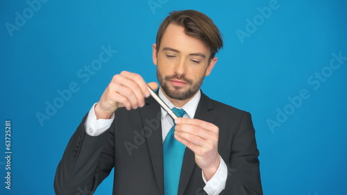 man topping up his e-cigarette and smoking