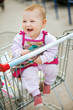Beautiful baby in shopping cart - trolley