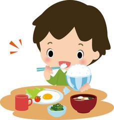 朝ごはんを食べる男の子