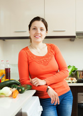 positive  woman in home kitchen