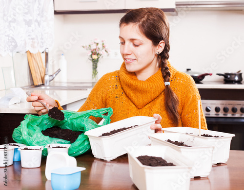 Girl planting seeds at table
