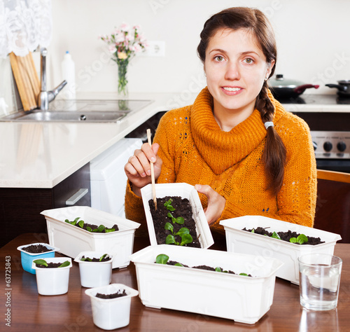 Girl at table with seedlings