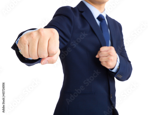 Businessman throwing punch
