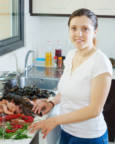 woman cooking produce from the sea