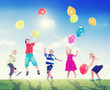 Multi-Ethnic Children Outdoors Playing With Balloons