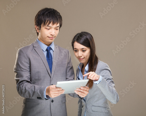 Asia business man and woman using tablet