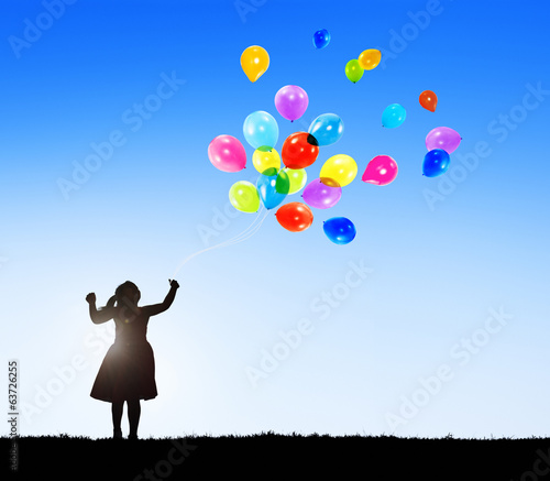 Silhouette of a Little Girl with Balloons