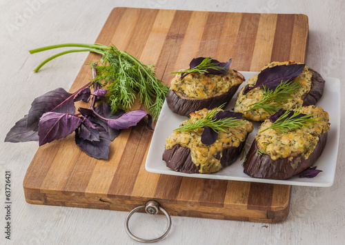 Slices of grilled eggplant with basil and cheese