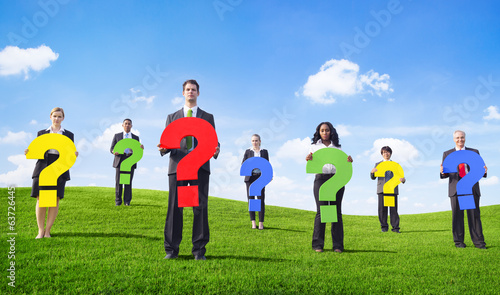 Business People Outdoors Holding Question Marks
