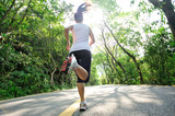 Fototapeta Runner athlete running on road.