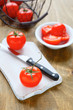 fresh tomatoes and a knife