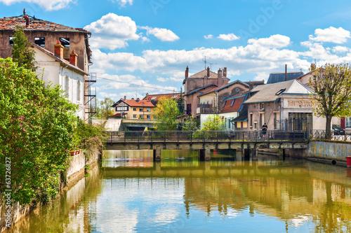 City on the water River Meurthe flowing in Saint-Nicolas-de-Port