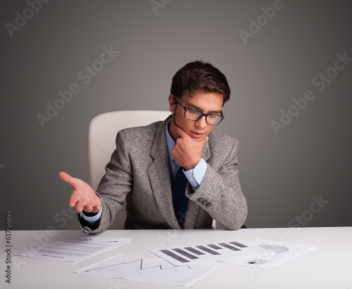 Businessman sitting at desk and doing paperwork