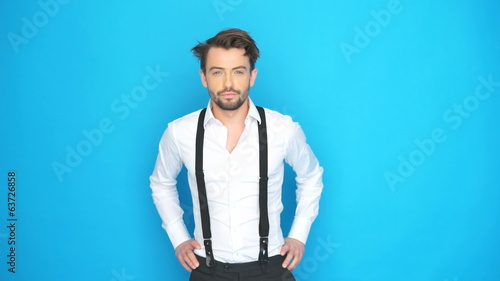 handsome man wearing shirt and braces on blue