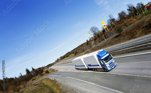 truck driving on scenic highway, elevated view
