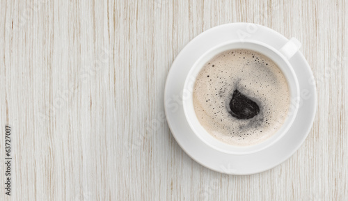 black coffee on white wooden table top view