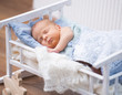 newborn baby  in a small bed