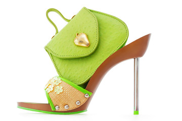 Green stiletto shoe and matching bag, isolated on white
