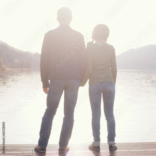 Couple holding hands on berth