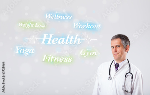 canvas print picture Clinical doctor pointing to health and fitness collection of wor