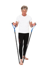 Senior fitness man exercising with blue elastics. Isolated on wh