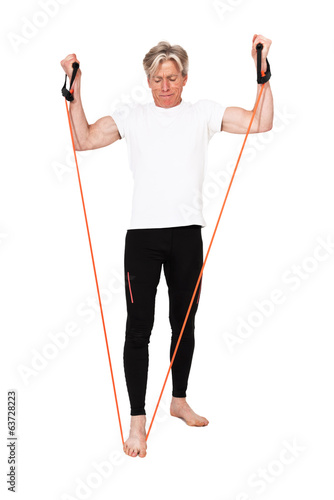 Senior fitness man exercising with orange elastics. Isolated on