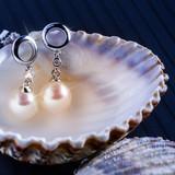 pearl earrings - 63728459