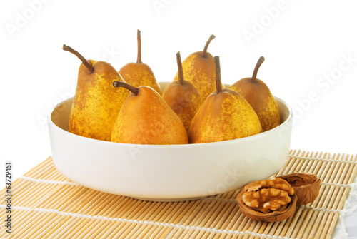 Yellow ripe pears with a walnut