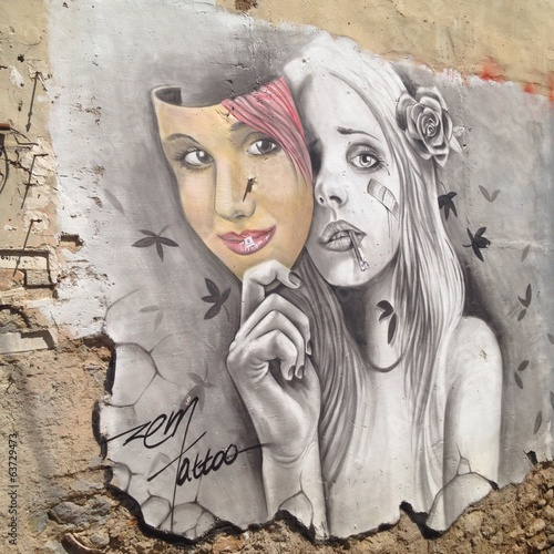 graffiti about young girl who wearing mask