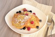 French toast with berries and powdered sugar